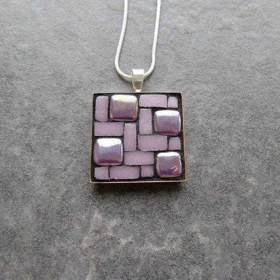 This mosaic pendant is made with a mixture of light purple iridescent and matt micro mosaic glass tiles. The matt tiles have been handcut by me into halves and quarters. The tiles that have been left whole are iridescent. The necklace is finished with black grout and the grout is sealed for protection against moisture. Silver plated square pendant base measuring 25mm x 25mm Silver plated snake chain (lead and nickel free) with lobster clasp in 18 or 24 (please select length from drop down…
