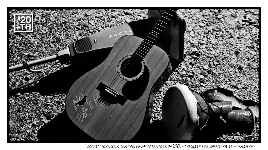 """Photo 144 of 365  Broken Acoustic Guitar, Drum and Vacuum 2012 - No Sleep For Banditos EP - Tulsa OK    These three disparate items came together to become icons for our latest Fanclub EP """"No Sleep For Banditos"""". Fanclub members, tell us your favorite tracks off the EP?    #Hanson #Hanson20th"""