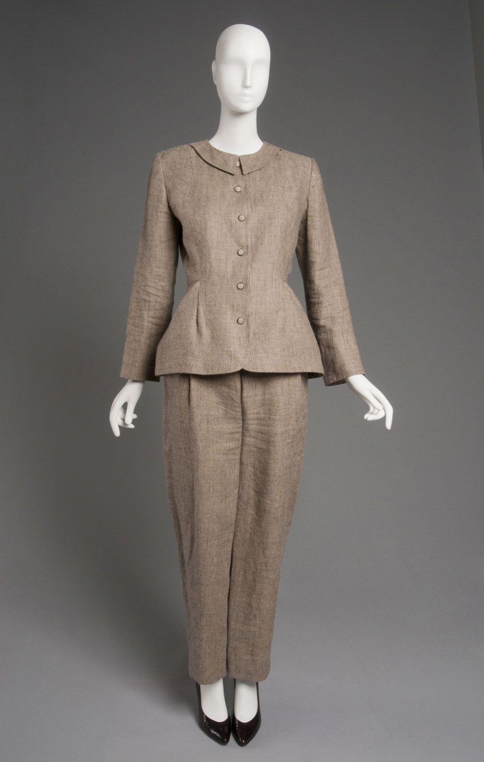 Geoffrey Beene Woman's Suit: Jacket and Trousers c. 1990 Medium: Black and tan striped linen plain weave