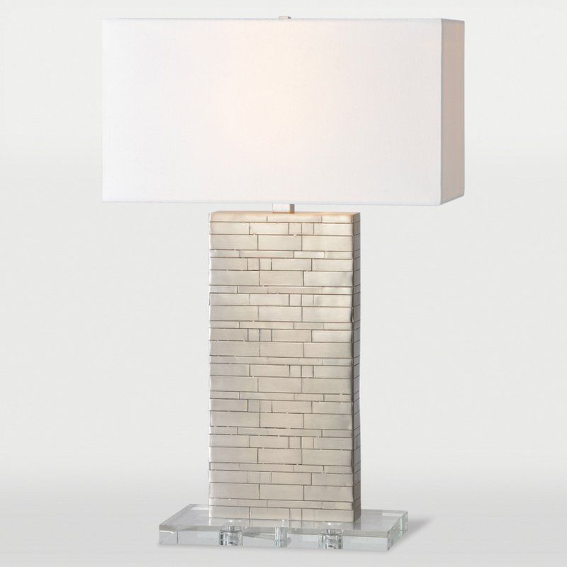 The renwil zagora table lamp has a delicately layered satin nickel plated metal brick patterned body which rests on a crystal base