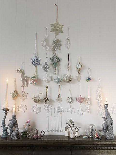 We love this 2D Christmas tree display. You could create this using slatwall or pegboard as well  #Christmas #decoration