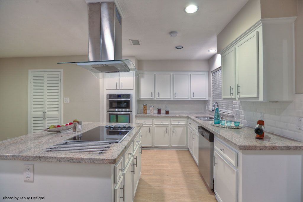 """Modern is always """"in."""" This bright kitchen and light hardwood floors come together to create an inviting and unique space. Thinking about remodeling your kitchen and want this look? Click the image to see how much it would cost."""