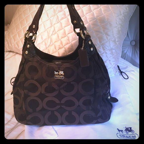Authentic brown coach bag Nearly perfect, slight wear on bottom and very slight use in interior with lavender inside. Coach Bags Shoulder Bags