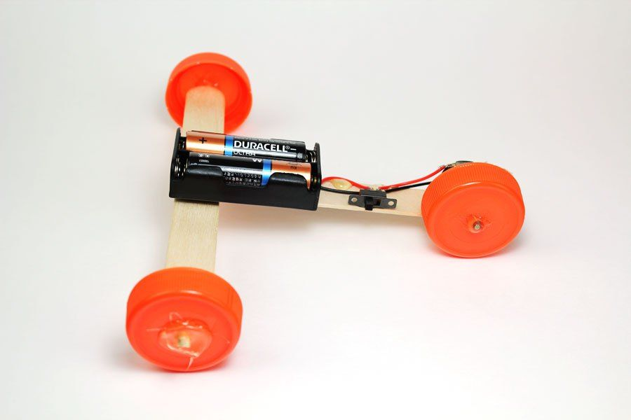 Create This Super Simple Stem Car Using Craft Sticks A Dc Motor And Aa Batteries Learn How To Creat Craft Stick Crafts Simple Circuit Projects Simple Circuit