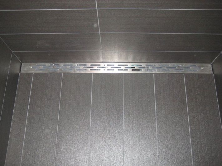 The Stainless Steel Strainer Of The Freestyle Linear Drain