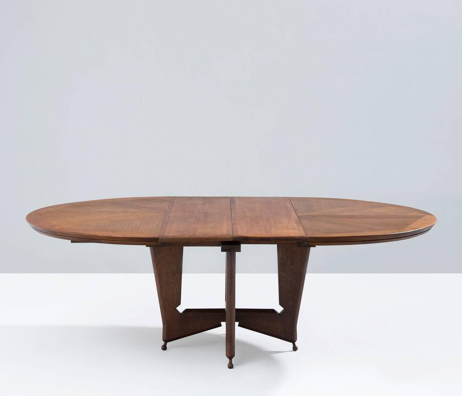 Extendible Round Dining Table by Guillerme et Chambron | From a unique collection of antique and modern dining room tables at https://www.1stdibs.com/furniture/tables/dining-room-tables/