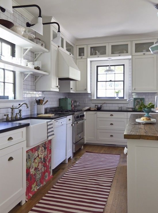 Beautiful Cottage Style Kitchen With White Shaker Cabinets Adorned Brass Cup Pull Hardware Black