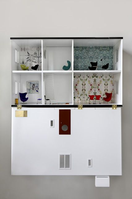 Wall mounted dolls house. Maybe it could be a little bit height adjustable too?
