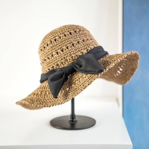 50e893d33 Hollow Hand crochet straw hat with bow UV beach womens wide brim sun ...