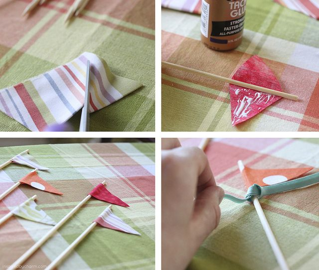 To  make the pennants just cut a diamond shape out of some pretty scraps of fabric. Apply some tacky glue to one side of the diamond, place a wooden skewer in the middle and folded the other side over. tye on some scraps of ribbon and rick rack to make it a little more interesting and fun! By {inspiredbycharm.com}