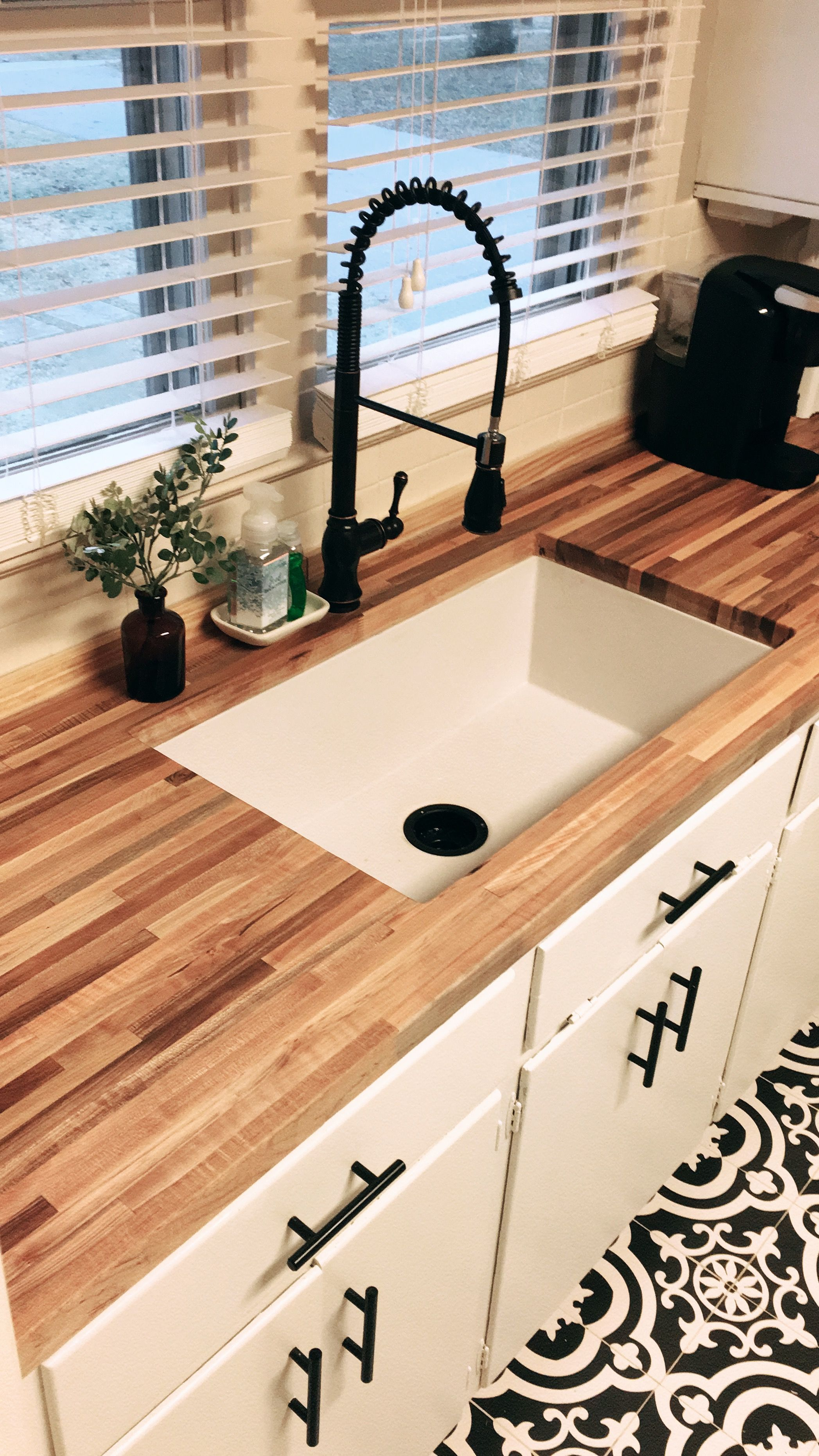Patterned tile floor, butcher block counters, white large single