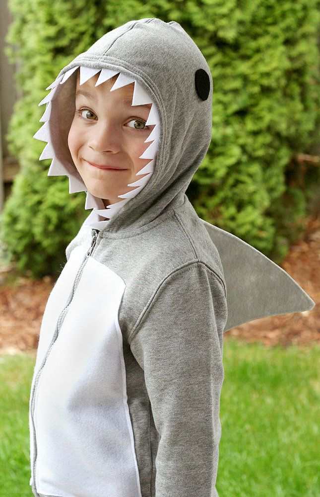 glue or sew teeth eyes and a fin onto a grey sweatsuit or hoodie for a quick and easy diy shark costume for kids - Quick And Easy Homemade Halloween Costumes For Kids