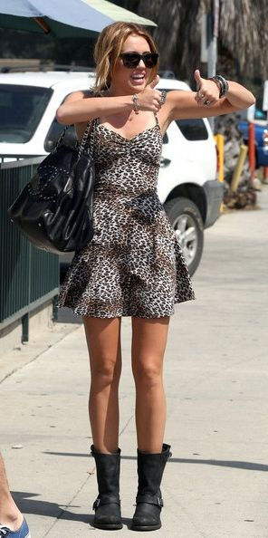 Mileycyrus Rocking Frye Boots With A Chanel Bag And Print Dress