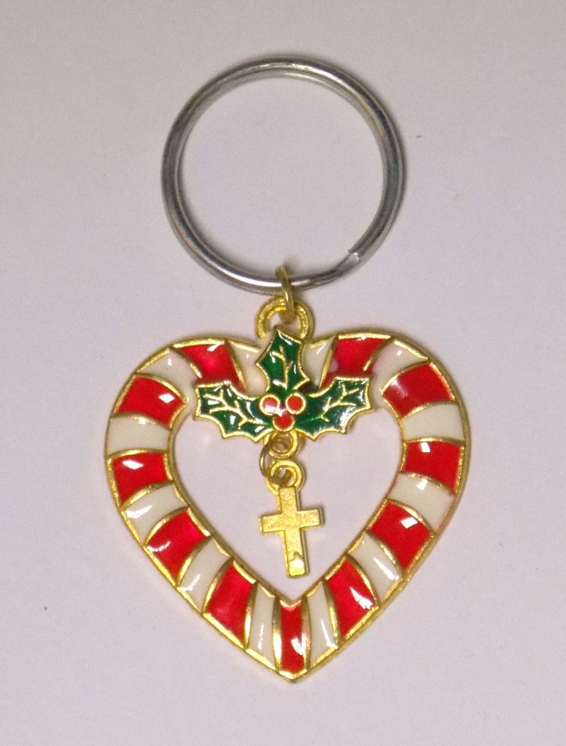 Heart shaped candy cane with holly and a gold cross key chain. Perfect for a Christmas stocking stuffer. #fashion #jewelry #bohemian #boho #sale