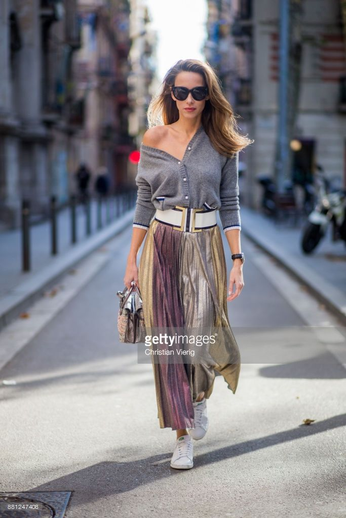 7c12895151 Alexandra Lapp wearing a long pleated metallic skirt with changing gold and  red colors
