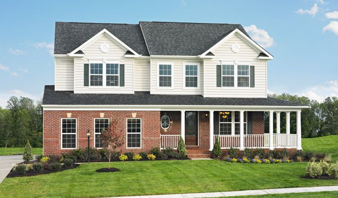 White And Brick Exterior With A Wraparound Porch! The