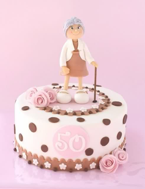 Prettily presented 50th birthday cake idea in pink and brown with