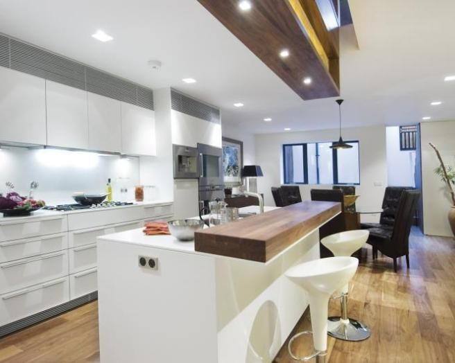 photo of contemporary open plan black white kitchen with breakfast bar  lighting small curved Google Search Kitchens