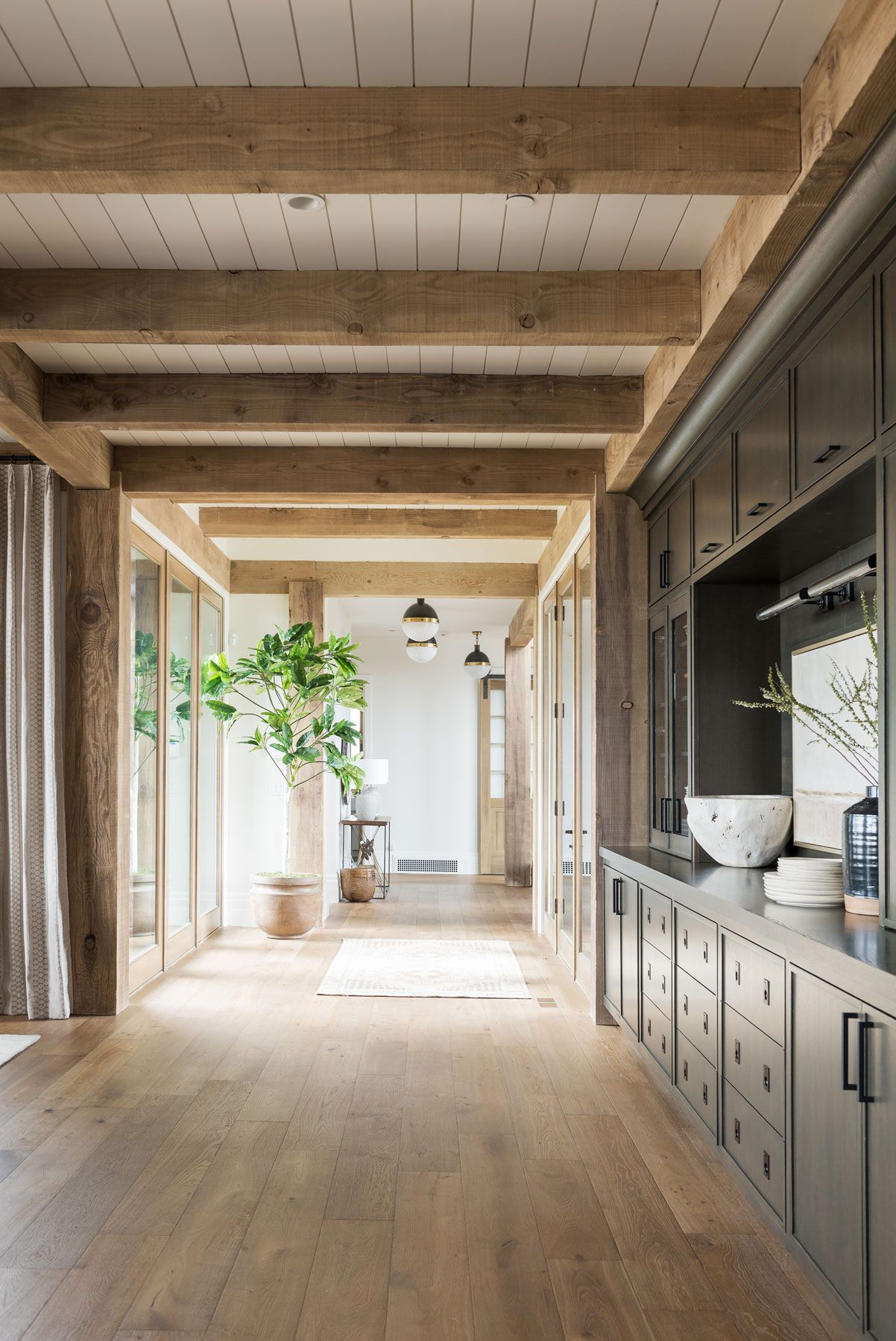 Ceiling Trends that Make a Major Statement | weathered ceiling beams in a mountain home | The Identite Collective