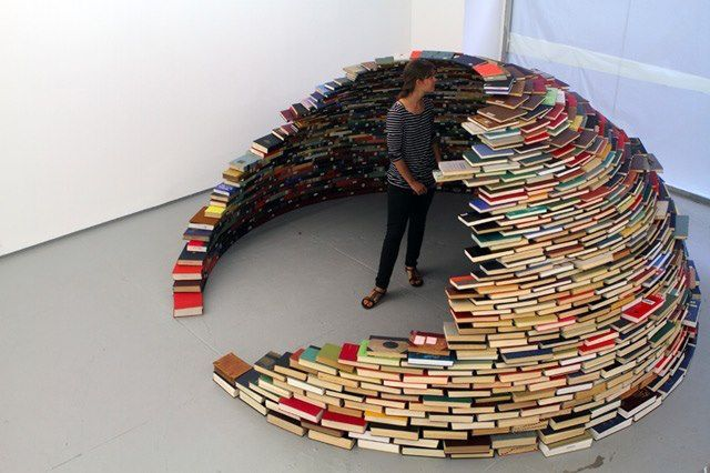 The best structure I have seen is this I think.This is constructed by Colombian artist Miler Lagos.Nothing used except books when this structure constructed.