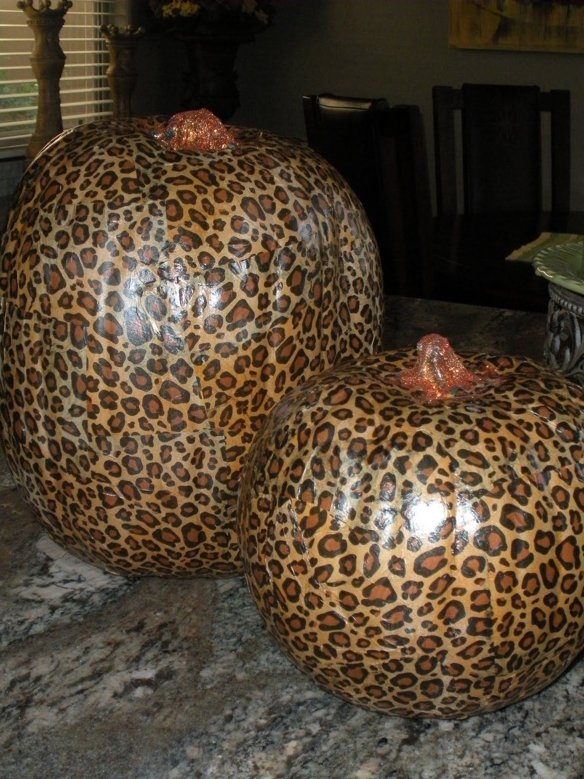Not a fan of leopard print but I do love the idea of tissue paper mod podge pumkins, although I don't think this would work for pumpkins outdoors