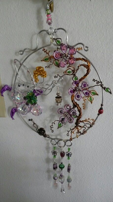 Wire wrapped beaded sun catcher with snail flowers and fairy