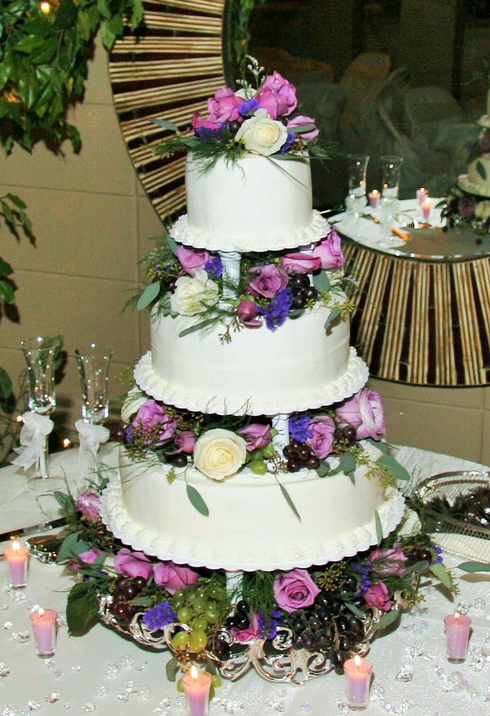 3 Tier Round Wedding Cake With Columns And Purple White Flowers