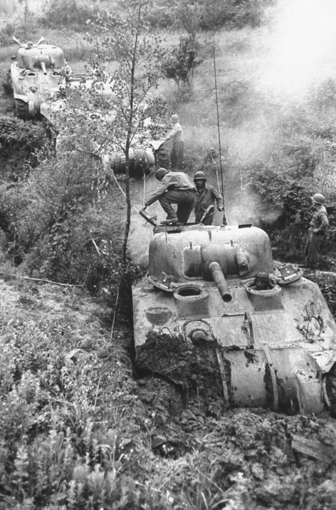 Column of American M4 Sherman tanks bogged down in the mud near Minturno during the campaign to drive German forces from Italy, 1944.