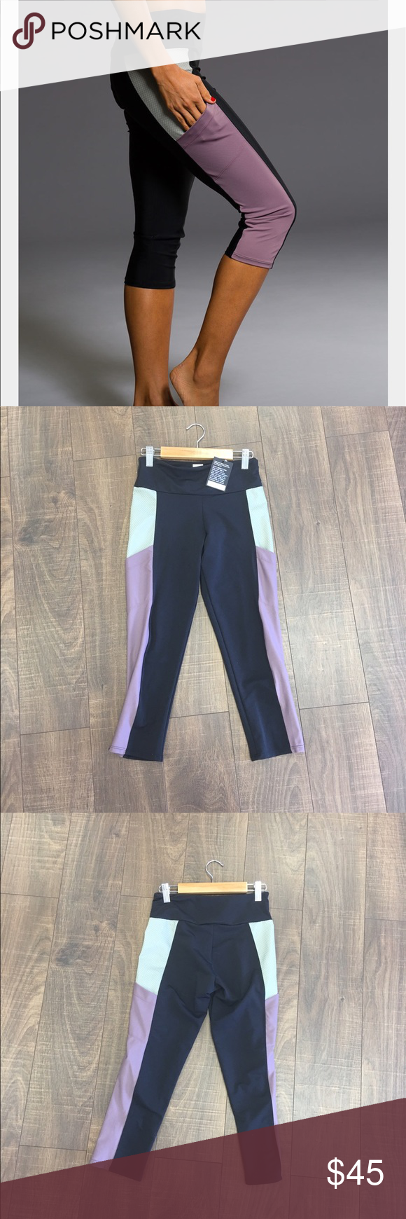 Onzie Pocket Capri in Purple Haze Combo Keep your valuables close and your style points high in the Pocket Yoga Capri. This tight features two side pockets on shorter capri-style legs for a sporty look. Color-blocked paneling adds to the this already-fun look. Onzie Pants Capris