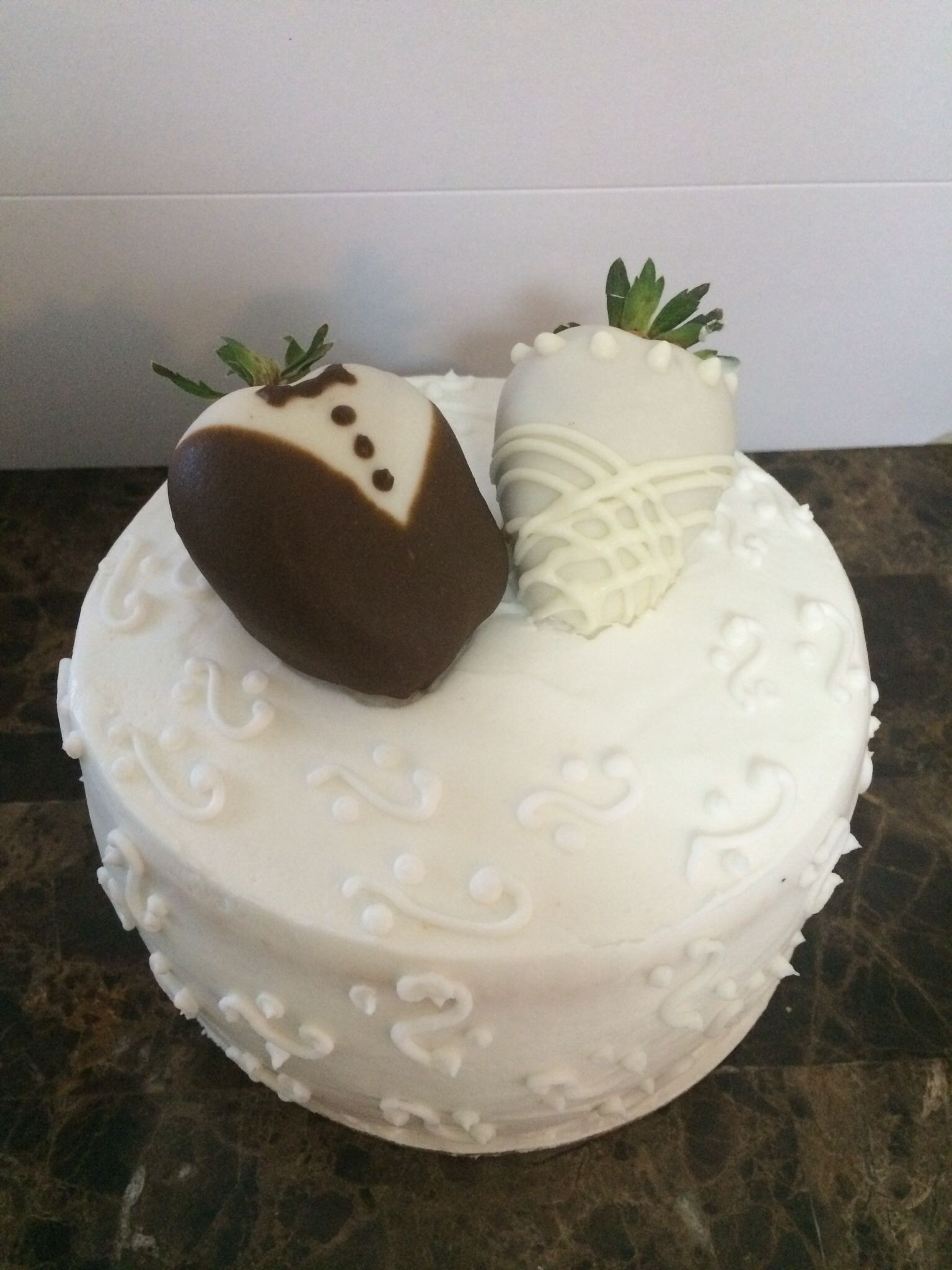 First wedding anniversary cake with bride and groom strawberries ...