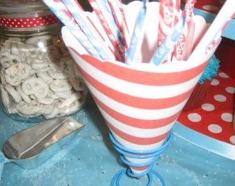 Roll decorative paper and fill with popcorn, candy etc