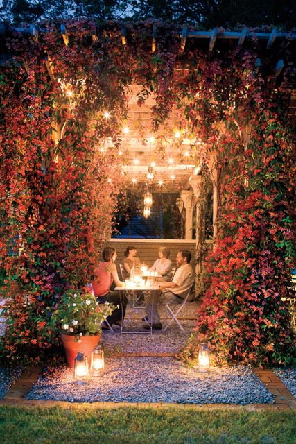 How GORGEOUS is this backyard arbor? Draped in flowering vines, it looks magical!