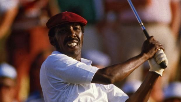 Calvin Peete follows through on his second shot at No. 18 of the Stadium Course at TPC Sawgrass during the final round of the 1985 Players Championship. Peete was the first African-American to win the PGA Tour's marquee event.