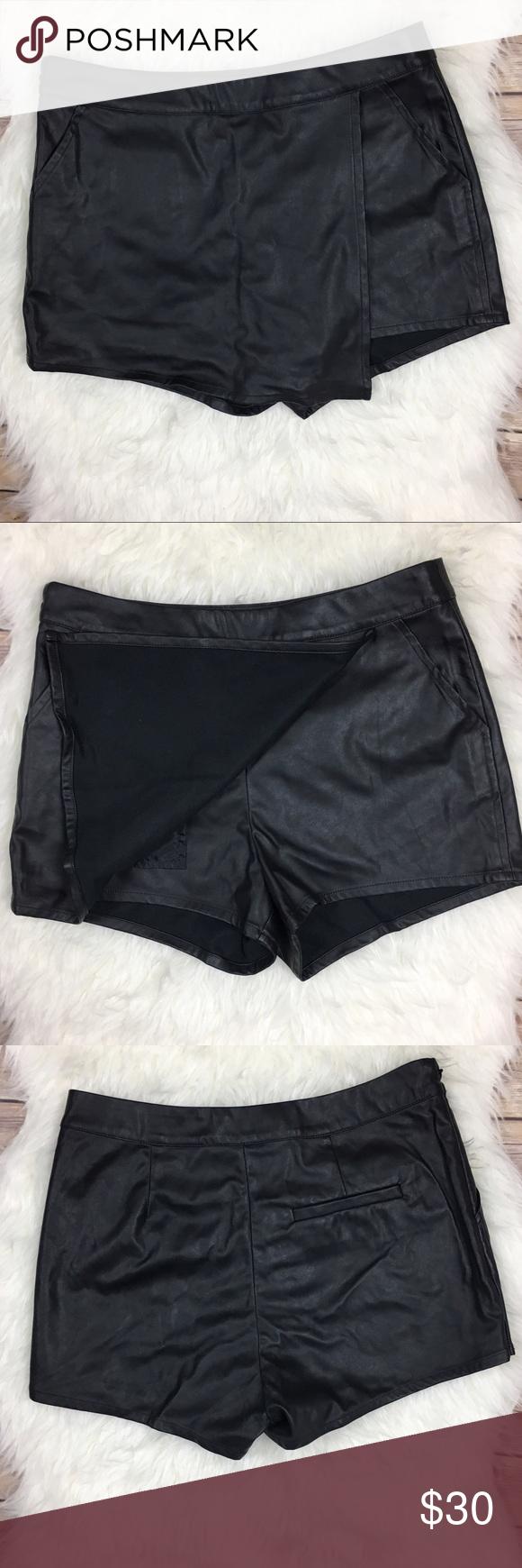 "H&M Black Faux Leather Skort H&M Black Faux Leather Skort. Size 8 100% Polyester measurements laying flat waist 15"" length 12"" rise 9.5"" inseam 2"". H&M Shorts Skorts"