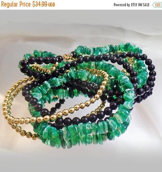 This #vintage three strand beaded necklace is gorgeous!  It features a three strands, with one gold tone strand, one black Lucite strand, and one faux green jade strand, als... #ecochic #etsy #jewelry #jewellery
