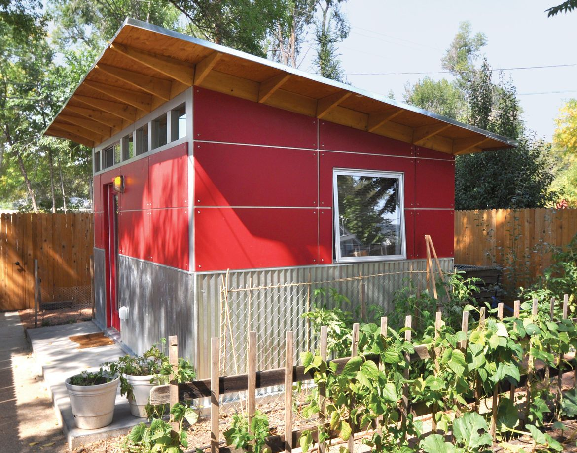 a backyard shed clad in collins truwood siding and corrugated