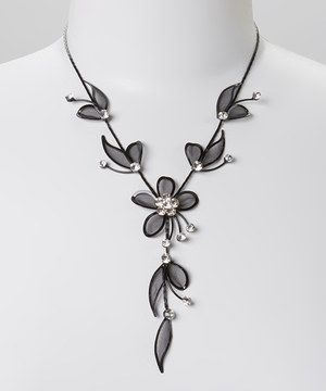 Enchant an outfit with this stunning, singular piece. Its crystal-topped flowers shimmer in the light, enchanting onlookers.