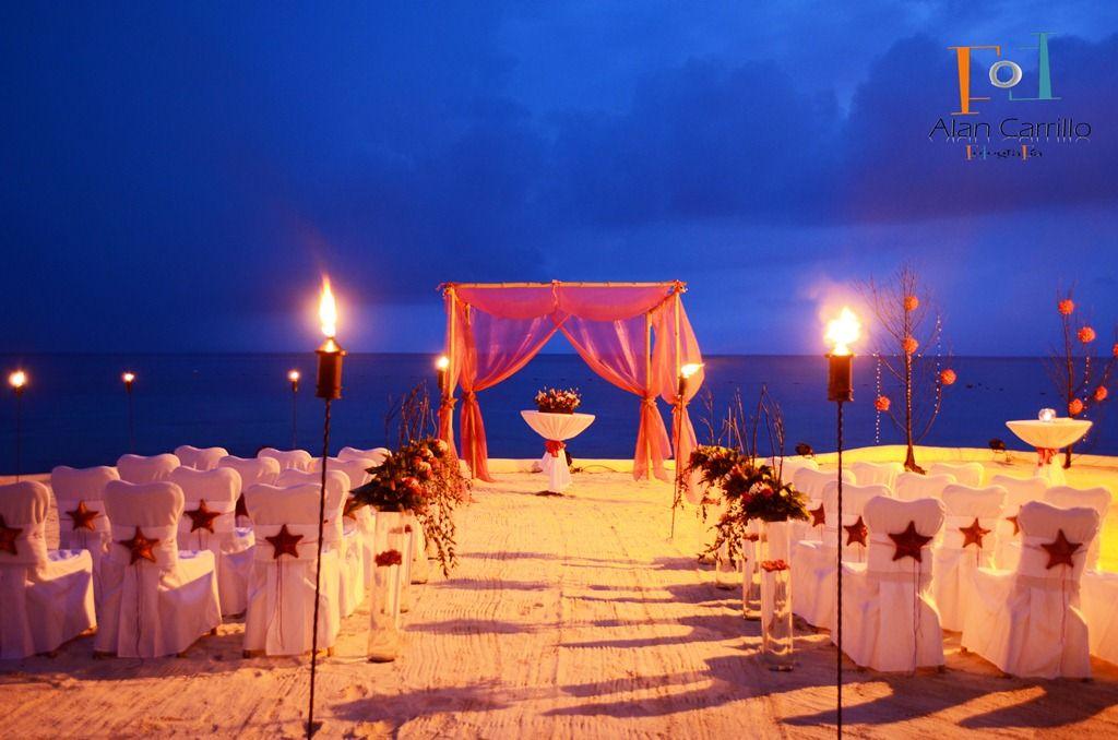 Weddings In Cozumel Presidente Intercontinental Beach Wedding Ceremony Lighted By Tiki Torches