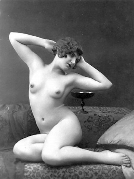 A vintage lovely proudly showing off her small firm .....elbows.