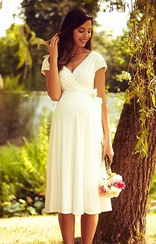38f0b0ab847a7 Our best-selling cross over maternity dress is now here in a beautiful knee  length bridal version.