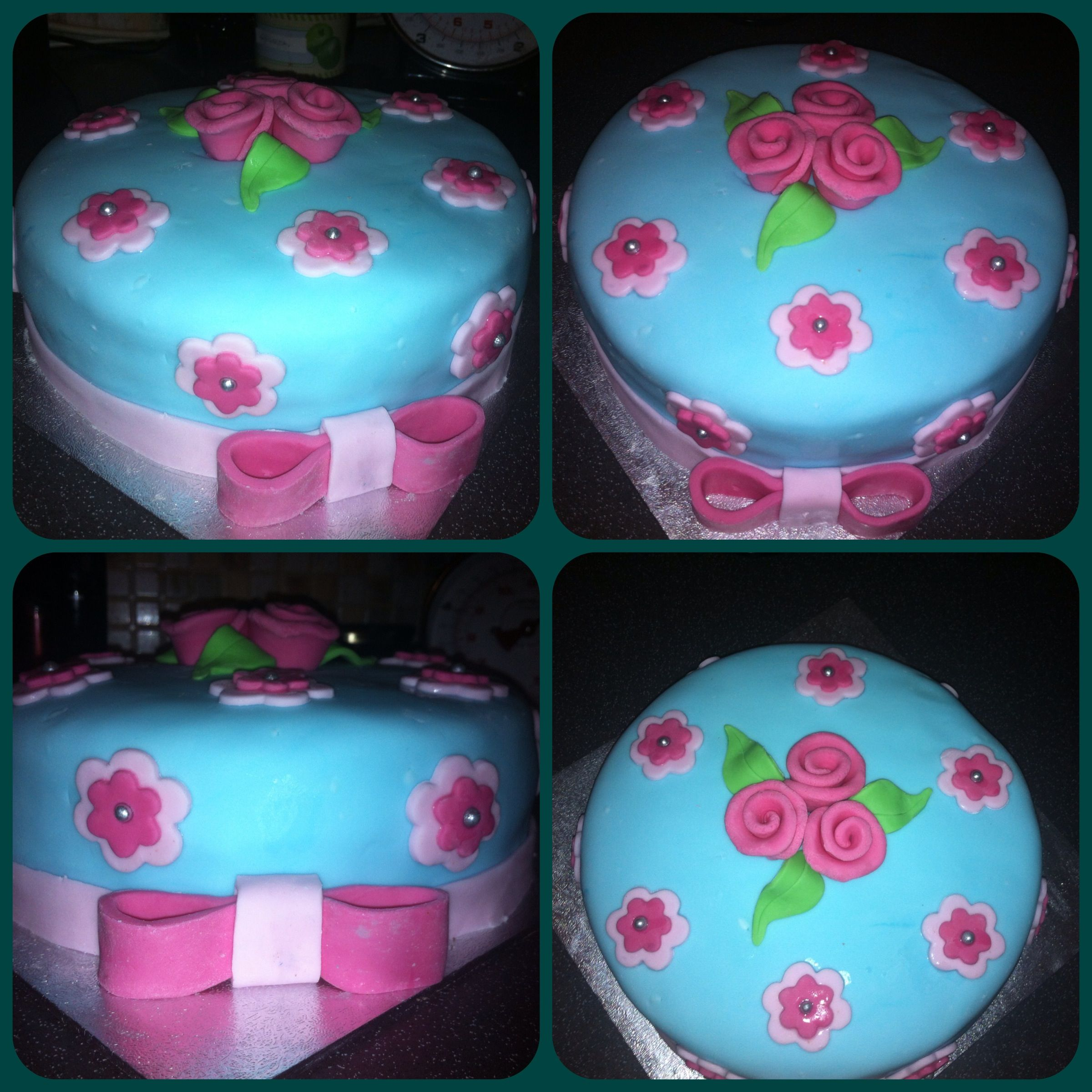 Pretty blue cake with pink flowers and bow