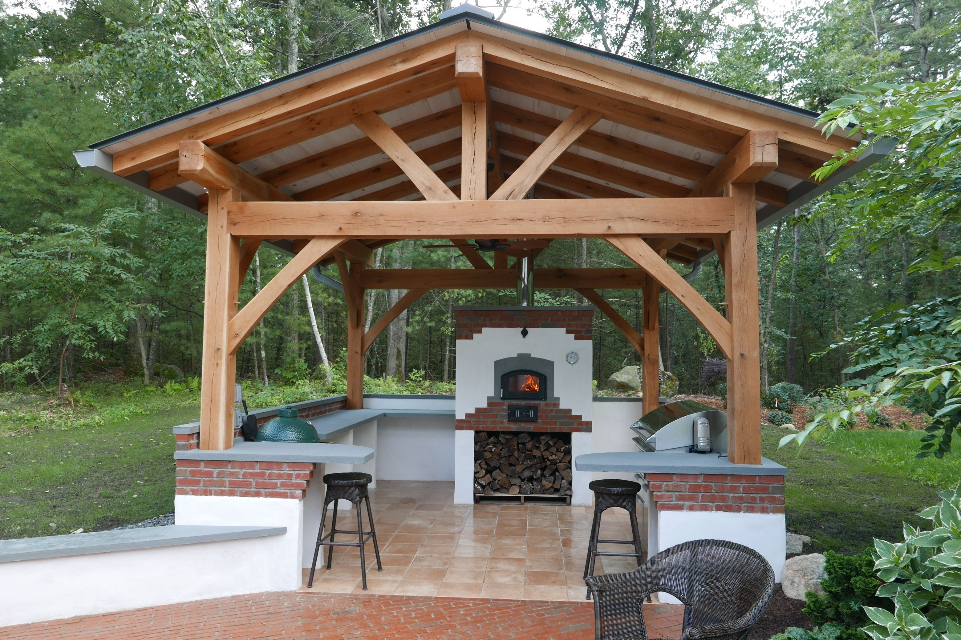 Beautiful Cedar Gazebo With A Gable Roof And Neatly Organized Stone With Fireplace Simple Yet Creative Backyard Additi Grill Gazebo Roof Paint Outdoor Kitchen