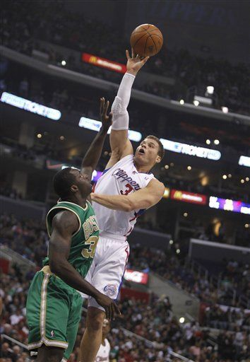 Los Angeles Clippers' Blake Griffin, right, goes to the basket over Boston Celtics forward Brandon Bass in the first half of an NBA basketball game in Los Angeles on Monday, March 12, 2012.