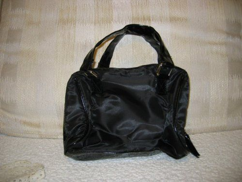 Avon Black Zip Top Bag Tote Cosmetic Bag Soft & Roomy by Avon Cosmetics. $14.99. Can be wiped Clean. Small and Lightweight for shopping - Travel-Gym-etc.. Black Fabric Bag / Satin Type Finish with a Black Patant type trim and Handles. Zippered Top for Safety. Can be used for a lunch bag,or keep your camera,sewing,kids toys, snacks and much more. A Very roomy Cosmetic Bag which you can carry alone or in your purse-Perfect for your personal items when you travel-Lightweight to p...