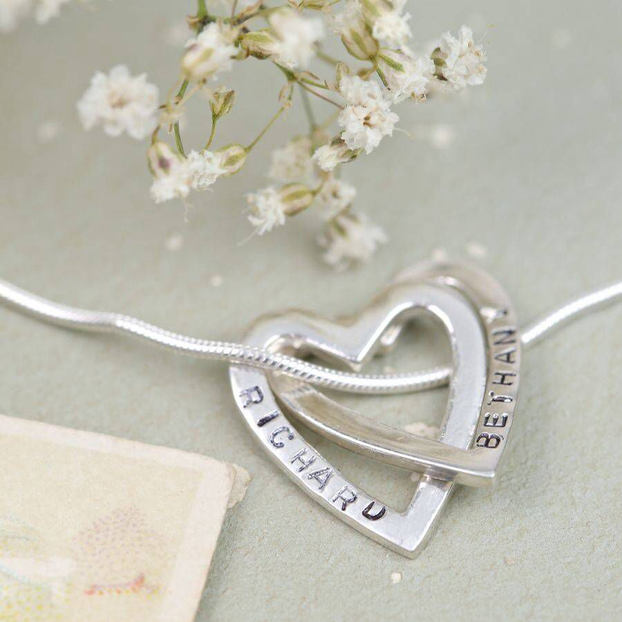 I've just found Personalised Sterling Silver Hearts Necklace.   High quality sterling silver necklace with two interlocking hearts.  Each heart is hand-stamped to your specification.   . £29.00