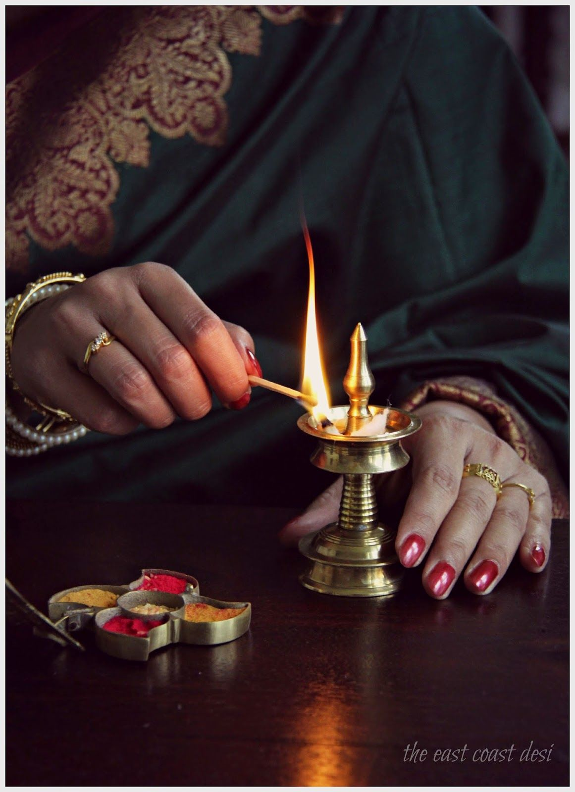 Vermilion Kum kum containers and brass diyas Indian Festive