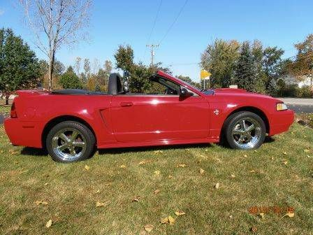Make:  Ford Model:  Mustang Year:  1999 Body Style:  Convertible Exterior Color: Red Interior Color: Charcoal Doors: Two Door Vehicle Condition: Good   For More Info Visit: http://UnitedCarExchange.com/a1/1999-Ford-Mustang-879056710691
