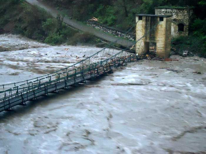 The Mandakini levels were so high it caused damage to a bridge in the Kedarnath Valley, india after the June 2013 floods posted by floodlist.com