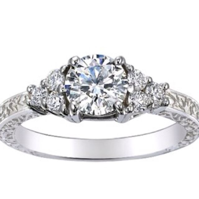 This with pink sapphire side stones... http://www.brilliantearth.com/Adorned-Trio-Diamond-Ring-White-Gold-BE149PCD18R6-492/?show_setting_tab=true