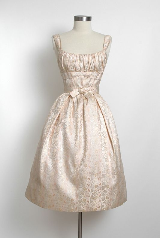 Late 1950's iridescent silk brocade dress.  ck this is one of the most feminine styles...